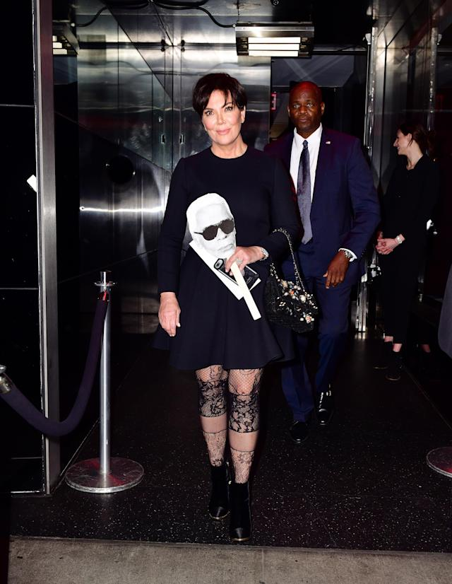 Kris Jenner leaves the party, carrying a Karl Lagerfeld mask, in NYC on Oct. 23. (Photo: James Devaney/GC Images)
