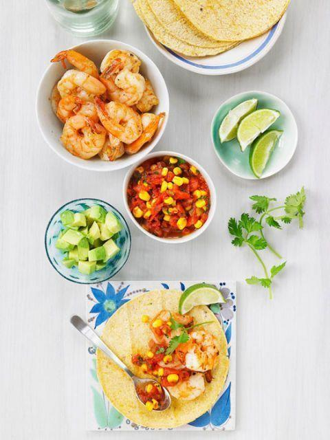 """<p>Prawn and fresh corn salsa combined in corn tortillas for a refreshing and low-calorie meal.</p><p>Get the <a href=""""https://www.delish.com/uk/cooking/recipes/a30380256/shrimp-taco-warm-corn-salsa-recipe/"""" rel=""""nofollow noopener"""" target=""""_blank"""" data-ylk=""""slk:Prawn Tacos with Warm Corn Salsa"""" class=""""link rapid-noclick-resp"""">Prawn Tacos with Warm Corn Salsa</a> recipe. </p>"""