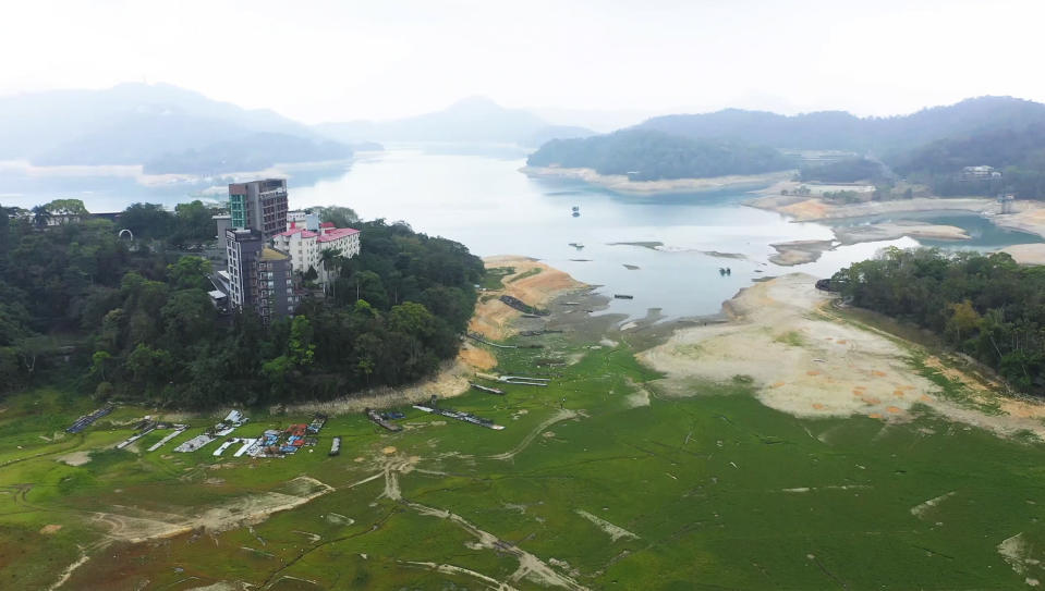 This photo taken by a drone and released by Nantou County Government, shows the shrinking Sun Moon Lake in Nantou county in central Taiwan on April 23, 2021. Some households in Taiwan are going without running water two days a week after a months-long drought dried up the island's reservoirs and a popular tourist lake. (Nantou County Government via AP)