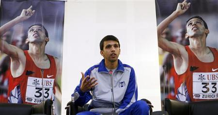 Retired Moroccan athlete Hicham El Guerrouj speaks to students at the Aspire Academy in Doha