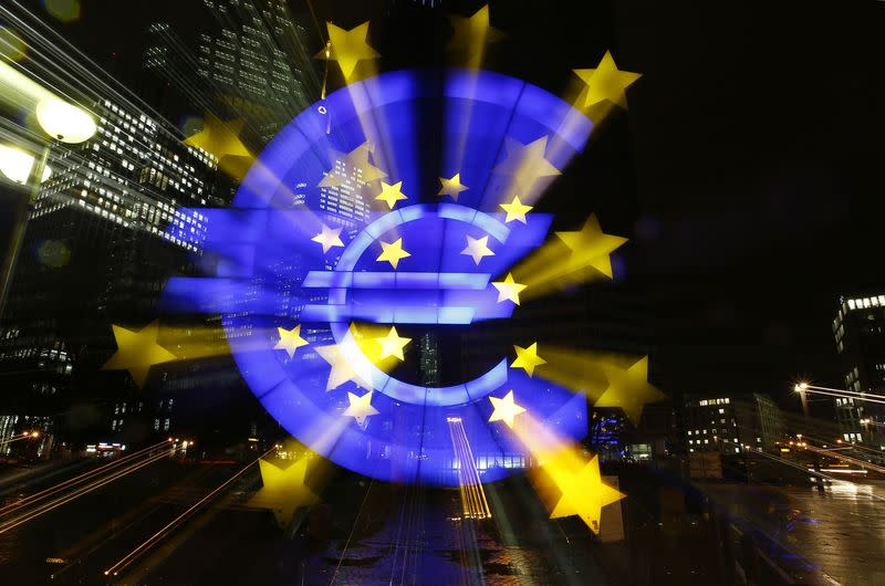 The famous euro sign landmark is photographed outside the former headquarters of the European Central Bank (ECB) in Frankfurt