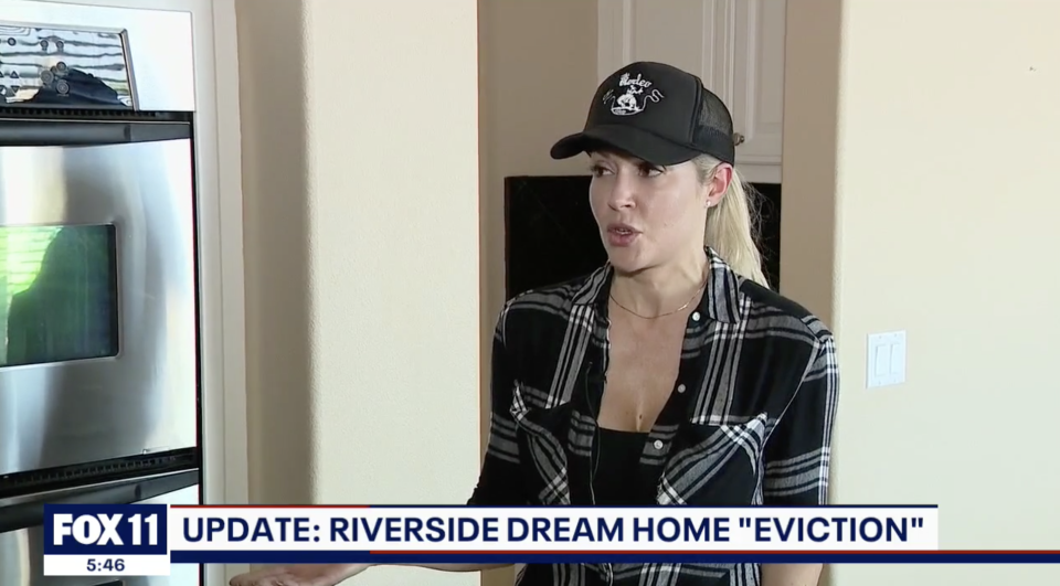 Pictured is Tracie Albert in her home she was locked out of for over a year.
