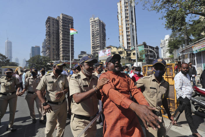 Activists shout slogans as police detain them during a protest against new farm laws in Mumbai, India, Wednesday, Jan. 27, 2021. Leaders of a protest movement sought Wednesday to distance themselves from a day of violence when thousands of farmers stormed India's historic Red Fort, the most dramatic moment in two months of demonstrations that have grown into a major challenge of Prime Minister Narendra Modi's government. (AP Photo/Rafiq Maqbool)