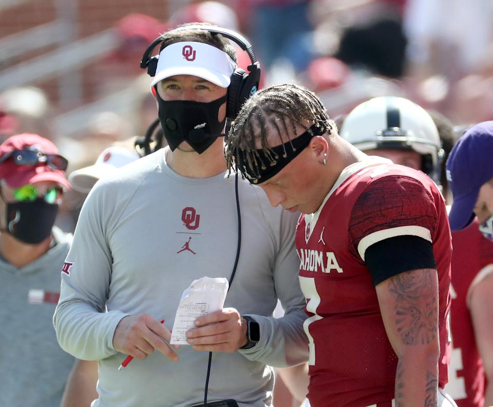 Oklahoma Sooners QB Spencer Rattler (7) speaks with head coach Lincoln Riley during the second half against Kansas State. (Kevin Jairaj-USA TODAY Sports)