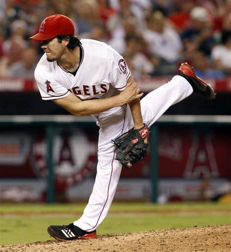 Los Angeles Angels starting pitcher Dan Haren delivers in the fifth inning of a baseball game against the Chicago White Sox in Anaheim, Calif., on Saturday, Sept. 22, 2012. (AP Photo/Christine Cotter)
