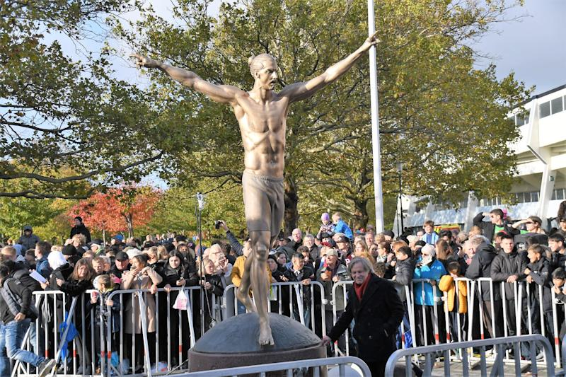 MALMO, SWEDEN - OCTOBER 8 : Fans take photo of a statue of Swedish soccer star Zlatan Ibrahimovic near Malmo Stadium, in Ibrahimovic's hometown Malmo, Sweden, 08 October 2019. The 2,7 meters bronze statue was created by Swedish sculptor Peter Linde. (Photo by Atila Altuntas/Anadolu Agency via Getty Images)