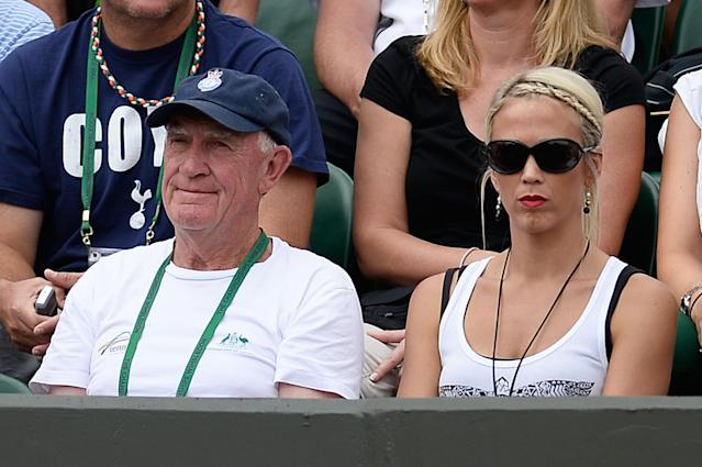 LONDON, ENGLAND - JUNE 26: Tony Roche and Lleyton Hewitt of Australia's wife Bec Hewitt watch his Gentlemen's Singles second round match against Dustin Brown of Germany on day three of the Wimbledon Lawn Tennis Championships at the All England Lawn Tennis and Croquet Club on June 26, 2013 in London, England. (Photo by Dennis Grombkowski/Getty Images)