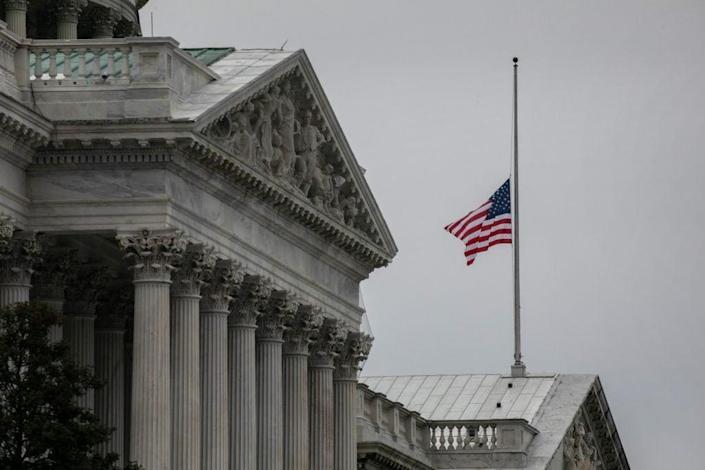 The American flag flies at half-staff at the U.S. Capitol on January 08, 2021 in Washington, DC. House Speaker Nancy Pelosi ordered the building's flags be flown at half-staff in honor of Capitol Police Officer Brian Sicknick, 42, who died after being injured during clashes with a pro-Trump mob at the Capitol on Wednesday. Sicknick, a military veteran, was a 12-year member of the force. (Photo by John Moore/Getty Images)