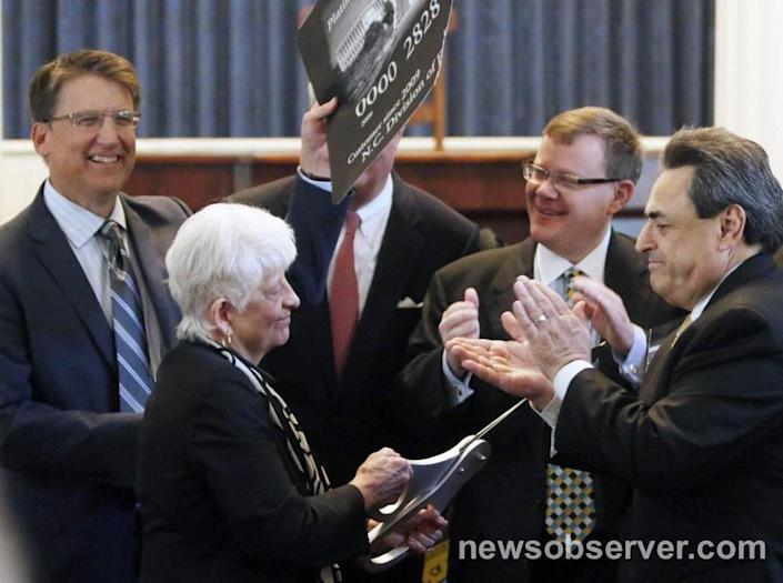 From left, NC Governor Pat McCrory, State Rep. Julia Howard, NC Commerce Secretary John Skvarla III, NC House Speaker Tim Moore, Sen. Bob Rucho participated in a ceremonial cutting up of a federal government credit card at a press announcement Tuesday, May 5, 2015 in the old NC House chamber in the State Capitol. The state announced the complete repayment of its debt to the federal government for unemployment insurance.