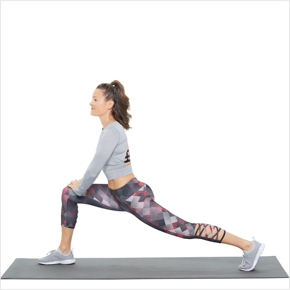 "<p>This dynamic lunge stretches the rectus femoris, ""a hip flexor and quad muscle,"" Dr. Darmanin said. This muscle can <a href=""https://www.popsugar.com/fitness/Best-Yoga-Poses-Sitting-All-Day-46419627"" class=""link rapid-noclick-resp"" rel=""nofollow noopener"" target=""_blank"" data-ylk=""slk:tighten up from sitting"">tighten up from sitting</a> and cause back, hip or knee pain, she said, so it's a good idea to loosen it up before you start walking.</p> <ul> <li>Start standing with your feet hips-width apart. Step your right foot forward and lower down slightly into a high lunge, so your knee doesn't quite form a 90-degree angle. Your left leg should be extended straight out behind you, far enough back so that your left heel is lifted off the ground. Ensure that your core is tight and your spine is straight with your hands on your hips. This is your starting position.</li> <li>Hold your torso and right (front) leg still as you bend your left knee slightly, lowering it but not all the way to the ground.</li> <li>Straighten your left leg again to return to the starting position.</li> <li>Repeat, making sure to do equal reps on both sides.</li> </ul>"