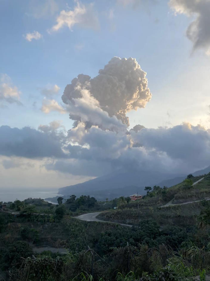 Plumes of ash rise from the La Soufriere volcano on the eastern Caribbean island of St. Vincent, Friday, April 16, 2021. An 1812 eruption killed dozens, mostly enslaved Black people. Prior to this month, the last big eruption was during Easter 1979, causing mass evacuations but no deaths. (Vincie Richie/The University of the West Indies Seismic Research Centre via AP)
