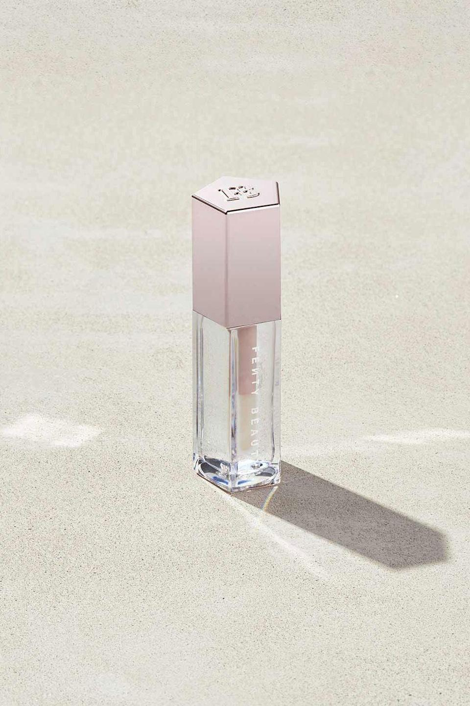 """<p><strong>Fenty Beauty</strong></p><p>fentybeauty.com</p><p><a href=""""https://go.redirectingat.com?id=74968X1596630&url=https%3A%2F%2Fwww.fentybeauty.com%2Fgloss-bomb-universal-lip-luminizer%2FFB50001.html%3Fdwvar_FB50001_color%3DFB5016%26cgid%3Dmakeup-lip-gloss&sref=https%3A%2F%2Fwww.cosmopolitan.com%2Fstyle-beauty%2Fbeauty%2Fg34399952%2Ffenty-beauty-sale-october-2020%2F"""" rel=""""nofollow noopener"""" target=""""_blank"""" data-ylk=""""slk:SHOP IT"""" class=""""link rapid-noclick-resp"""">SHOP IT </a></p><p><strong><del>$19</del> $12.82 (33% off)</strong></p><p>Available in a handful of colors, the Gloss Bomb Lip Luminizer will give your lips a nice, glossy finish. This formula is infused with shea butter to keep your lips hydrated.</p>"""