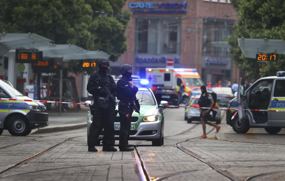 Police attend the scene of an incident in Wuerzburg, Germany, Friday June 25, 2021. German police say several people have been killed and others injured in a knife attack in the southern city of Wuerzburg on Friday. (Karl-Josef Hildenbrand/dpa via AP)