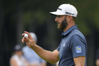 Dustin Johnson gestures after putting on the fourth green during the final round of the BMW Championship golf tournament, Sunday, Aug. 29, 2021, at Caves Valley Golf Club in Owings Mills, Md. (AP Photo/Nick Wass)