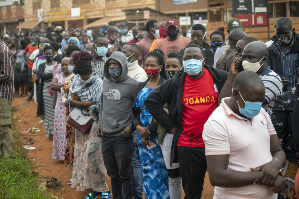Ugandans wait to vote in Kampala, Uganda, Thursday, Jan. 14, 2021.Ugandans are voting in a presidential election tainted by widespread violence that some fear could escalate as security forces try to stop supporters of leading opposition challenger BobiWine from monitoring polling stations.(AP Photo/Jerome Delay)