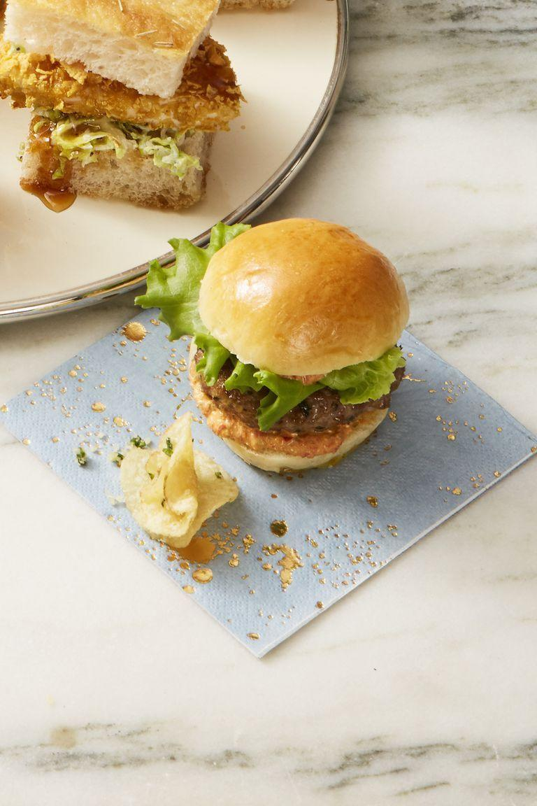 """<p>Make your Super Bowl party a little fancier by serving these lamb sliders instead of traditional burgers. </p><p><em><a href=""""https://www.goodhousekeeping.com/food-recipes/a25310634/lamb-sliders-with-pepper-relish-recipe/"""" rel=""""nofollow noopener"""" target=""""_blank"""" data-ylk=""""slk:Get the recipe for Lamb Sliders with Pepper Relish »"""" class=""""link rapid-noclick-resp"""">Get the recipe for Lamb Sliders with Pepper Relish »</a></em></p>"""