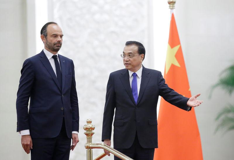 French Prime Minister Edouard Philippe and China's Premier Li Keqiang attend a welcome ceremony in Beijing