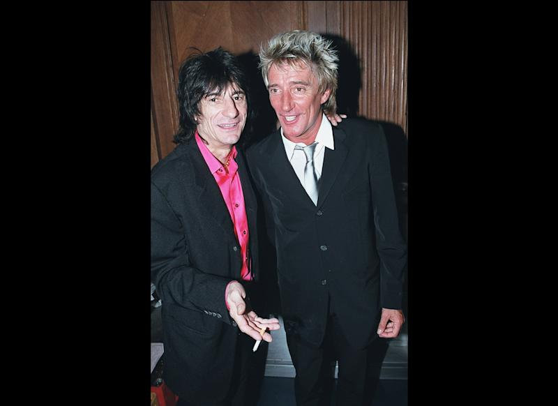 Pictured: Ronnie Wood and Rod Stewart of The Faces LONDON - 2000: Musician's Ronnie Wood (L) from the Rolling Stones and Rod Stewart party at Tramp nightclub to celebrate it's 30th anniversary in St James, London. (Photo by Dave Hogan/Getty Images)