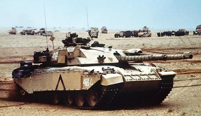 A British Challenger main battle tank, the squadron leader of D Sqn, Royal Scots Dragoon Guards, moves into a base camp along with other Allied armor during Operation Desert Storm.