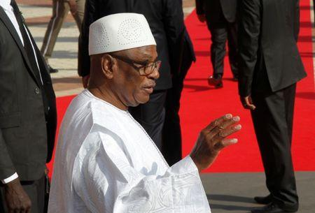 File photo: Keita waves as he is seen at the international conference center of Bamako during the France-Africa summit in Bamako