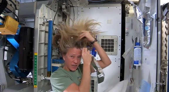 astronaut washing her hair in space - photo #11