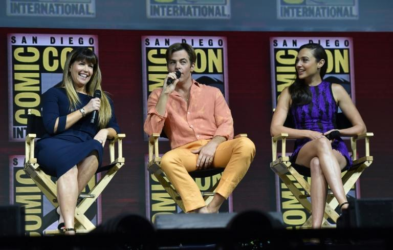 """Wonder Woman 1984"" sees director Patty Jenkins (L), reunite with stars Gal Gadot and Chris Pine"