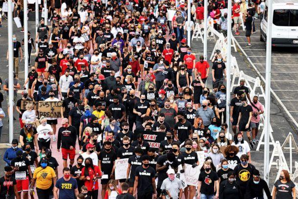 PHOTO: People participate in a march lead by the University of Louisville's Men's basketball team calling for justice for Breonna Taylor, Sept. 25, 2020, in Louisville, Kentucky. (Michael M. Santiago/Getty Images, FILE)