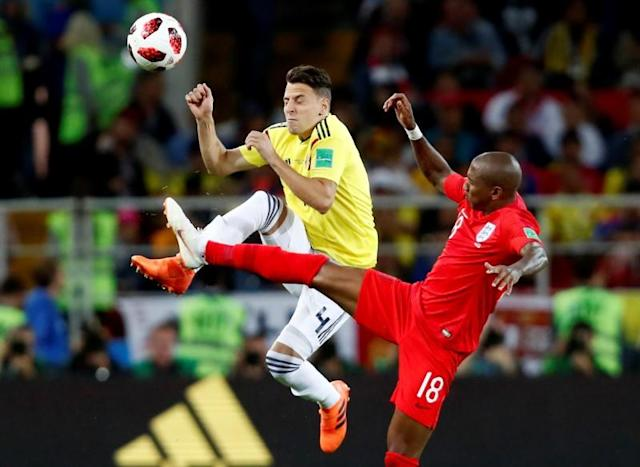 <p>Colombia's Santiago Arias in action with England's Ashley Young. REUTERS/Maxim Shemetov </p>