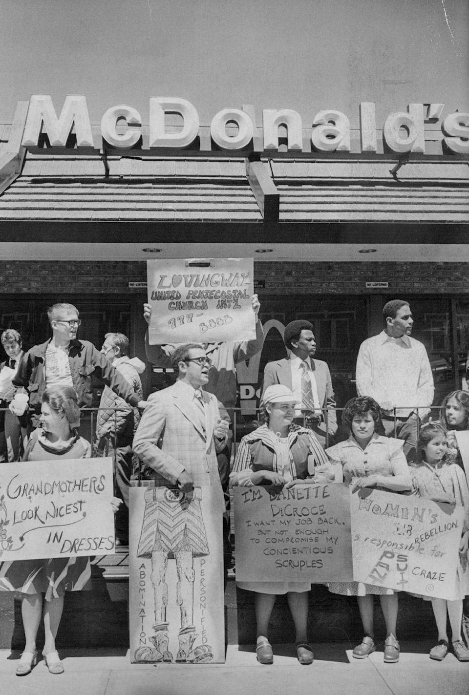 <p>Even McDonald's has had its fair share of conflict over the years. Members of Denver's Lovingway Inner City United Pentacostal Church protested the business when managers wouldn't allow a church member to work there wearing a dress. Danette DiCroce (pictured in the hat) was fired for not adhering to their pants-only dress code, only to be rehired soon after. Today, the typical McDonald's uniform still consists of slacks and a shirt. </p>