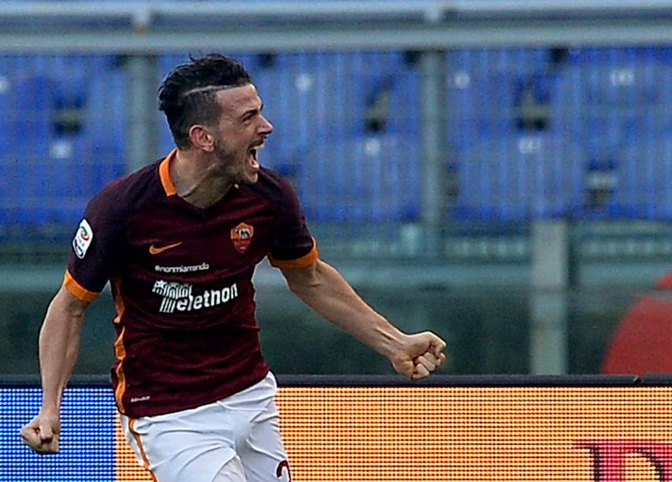 Roma's Alessandro Florenzi celebrates after scoring during the Serie A match against Genoa at the Olympic Stadium in Rome on December 20, 2015 (AFP Photo/Tiziana Fabi)