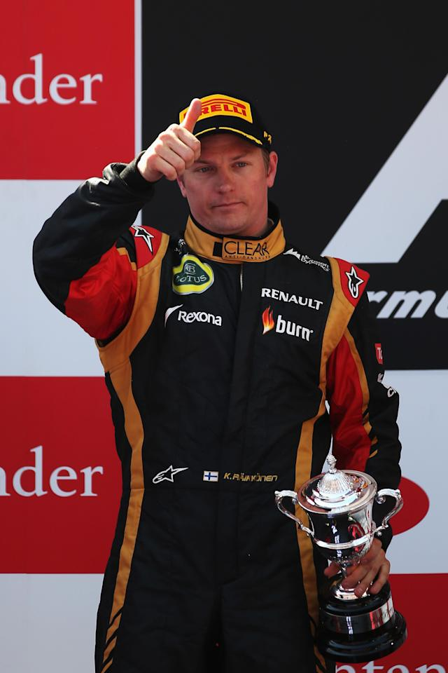 MONTMELO, SPAIN - MAY 12: Kimi Raikkonen of Finland and Lotus celebrates finishing second during the Spanish Formula One Grand Prix at the Circuit de Catalunya on May 12, 2013 in Montmelo, Spain. (Photo by Mark Thompson/Getty Images)