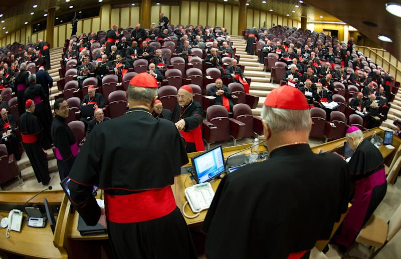 In this photo provided by the Vatican newspaper L'Osservatore Romano, cardinals attend a meeting, at the Vatican, Monday, March 4, 2013. Cardinals from around the world have gathered inside the Vatican for their first round of meetings before the conclave to elect the next pope, amid scandals inside and out of the Vatican and the continued reverberations of Benedict XVI's decision to retire. (AP Photo/L'Osservatore Romano, ho)