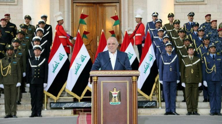 A picture released by the Iraqi premier's office on December 9, 2017 shows Prime Minister Haider al-Abadi announcing the end of a three-year war against the Islamic State jihadist group