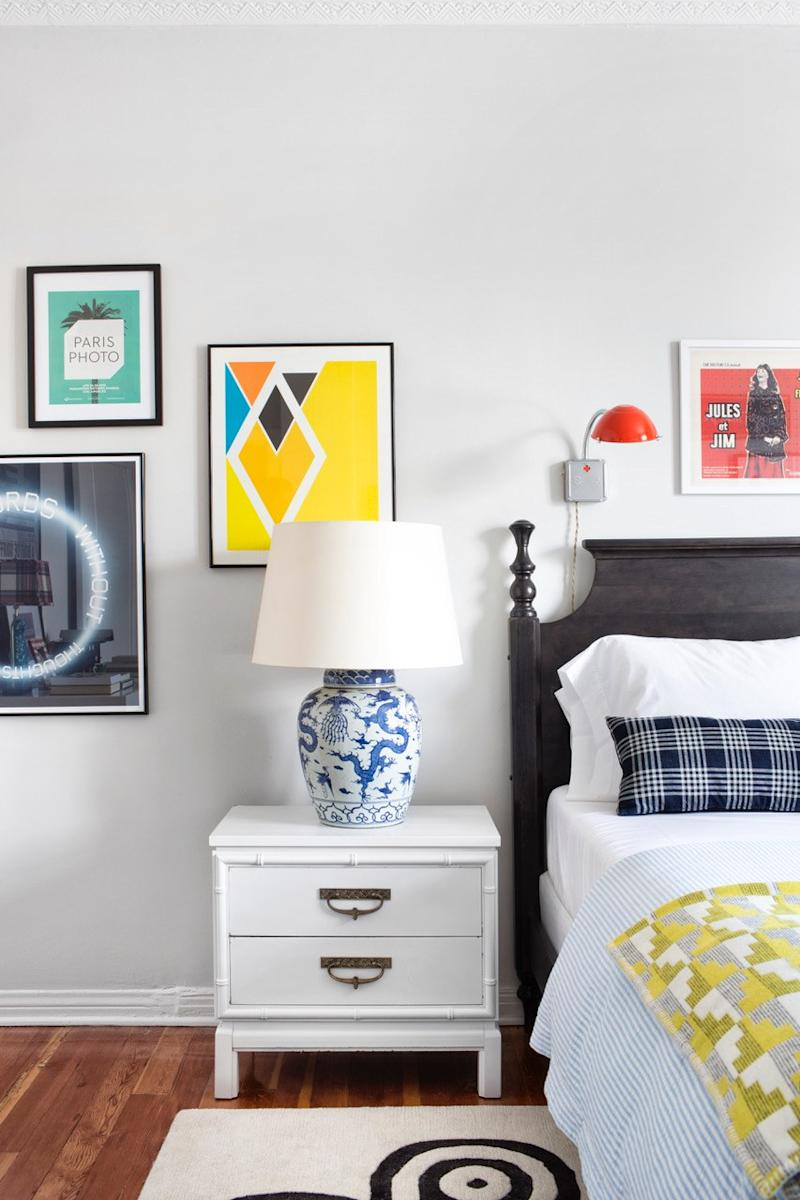 Colorful artwork brightens up a bedroom designed by Max.