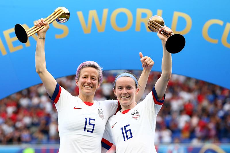 LYON, FRANCE - JULY 07: Megan Rapinoe with her Gold Ball award, celebrates with Rose Lavelle and her Bronze Ball award after the 2019 FIFA Women's World Cup France Final match between The United State of America and The Netherlands at Stade de Lyon on July 07, 2019 in Lyon, France. (Photo by Maddie Meyer - FIFA/FIFA via Getty Images)