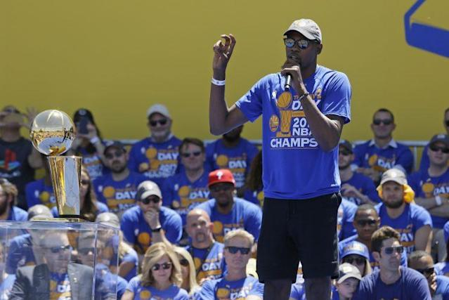 Kevin Durant addresses the crowd during the Warriors' championship parade. (AP)