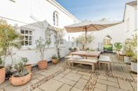 """<p>Set in surfers' village Braunton, this beautiful Airbnb in Devon offers coastal chic at its very best. You'll feel like you're at the seaside before you even hit the beach thanks to the light and airy interiors with a subtle coastal theme. </p><p>Think sofas straight out of a beach house you'd find on America's east coast, blues and whites throughout and beach art. There's a private courtyard for soaking up the sun and a private walled garden with a play house and fruit you're welcome to pick.</p><p><strong>Sleeps</strong>: 4</p><p><strong>Price per night:</strong> £200</p><p><strong>Why we love it:</strong> There are plenty of peaceful spots to catch some rays while you lose yourself in a good book and listen to the distant waves.</p><p><a class=""""link rapid-noclick-resp"""" href=""""https://www.airbnb.co.uk/rooms/plus/9109536"""" rel=""""nofollow noopener"""" target=""""_blank"""" data-ylk=""""slk:SEE INSIDE"""">SEE INSIDE</a></p>"""