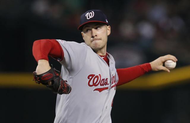 Washington Nationals pitcher Patrick Corbin throws against the Arizona Diamondbacks in the first inning of a baseball game, Sunday, Aug. 4, 2019, in Phoenix. (AP Photo/Rick Scuteri)