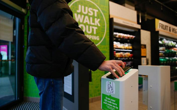 As you enter the store, you scan your phone, and an array of cameras and sensors track each item you pick up - Hollie Adams/Bloomberg