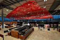 """A feature of the interior of Germany's third-largest airport is the """"Magic Carpet"""" artwork by American artist Pae White suspended from the ceiling"""