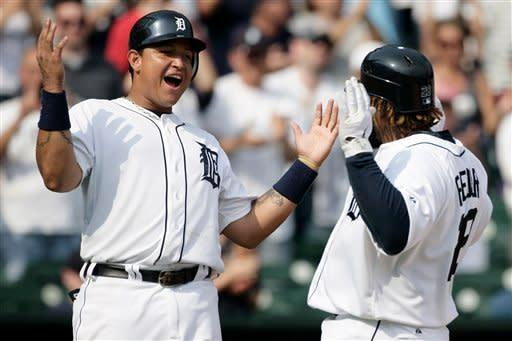 Detroit Tigers' Prince Fielder, right, celebrates his three-run home run with Miguel Cabrera in the eighth inning of a baseball game against the Minnesota Twins, Thursday, July 5, 2012, in Detroit. The Tigers won 7-3. (AP Photo/Duane Burleson)
