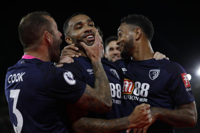 Bournemouth's Callum Wilson, center, celebrates with Bournemouth's Joshua King, right and Bournemouth's Steve Cook after scoring his side's third goal during the English Premier League soccer match between Southampton and Bournemouth at St Mary's stadium in Southampton, England, Friday, Sept. 20, 2019. (AP Photo/Kirsty Wigglesworth)
