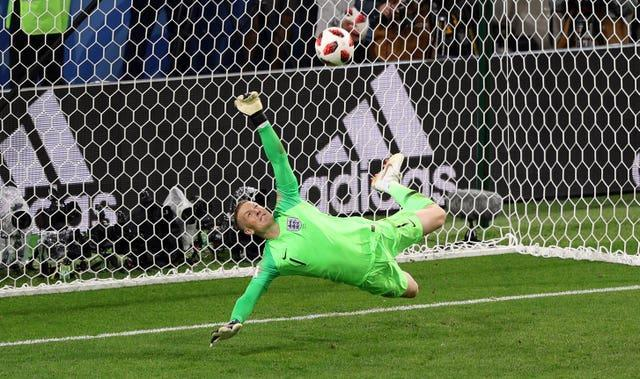 England goalkeeper Jordan Pickford saves a penalty from Colombia's Carlos Bacca during the 2018 World Cup (Aaron Chown/PA)