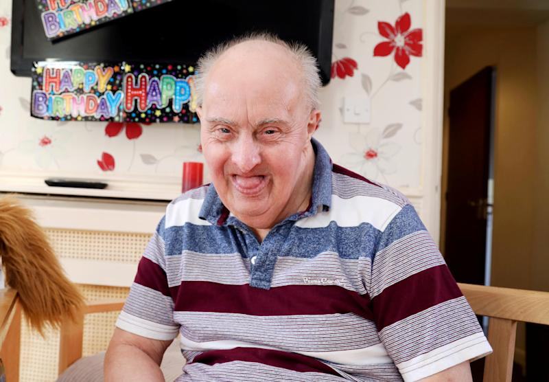 Robin Smith, the oldest man with Down's Syndrome has tragically died, pictured here in October 2019. (SWNS)