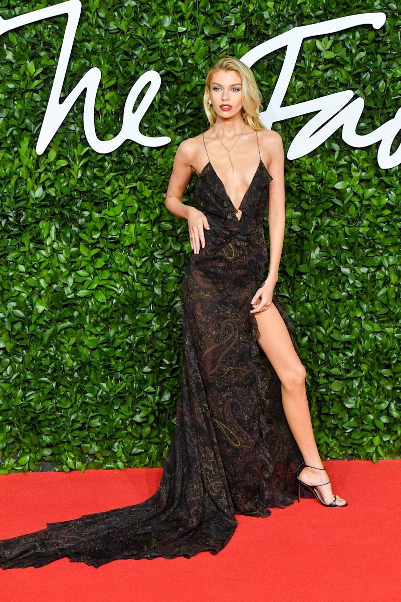 Stella Maxwell arrived wearing a plunging lacy number at The Fashion Awards. Photo: Getty Images
