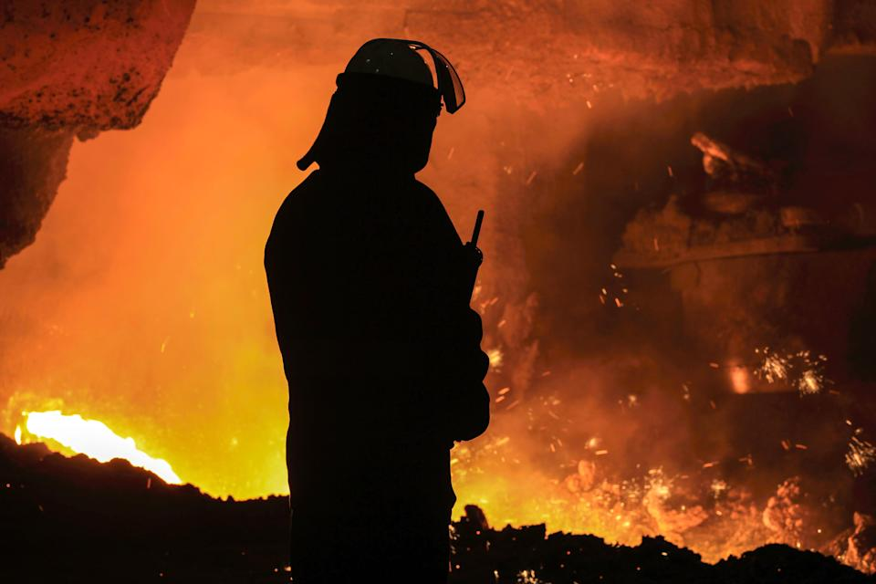 "A steelworker watches as molten steel pours from one of the Blast Furnaces during 'tapping' at the British Steel - Scunthorpe plant in north Lincolnshire, north east England on September 29, 2016. Thursday September 29, marks 100 days since the British Steel conglomerate bought the ailing plant from Indian company Tata Steel. In a recent interview, Gareth Stace, director of UK Steel, Britain's steel trade organisation said, ""I welcome that they have brought the British Steel brand back to life. I think fundamentally it's a good and viable business and should have a strong viable future."" / AFP / Lindsey Parnaby        (Photo credit should read LINDSEY PARNABY/AFP via Getty Images)"