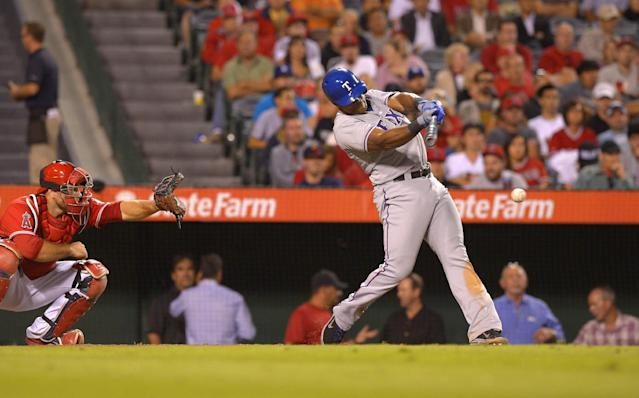 Texas Rangers' Adrian Beltre, right, hits an rBI single as Los Angeles Angels catcher Chris Iannetta catches during the eighth inning of their baseball game, Tuesday, Aug. 6, 2013, in Anaheim, Calif. (AP Photo/Mark J. Terrill)