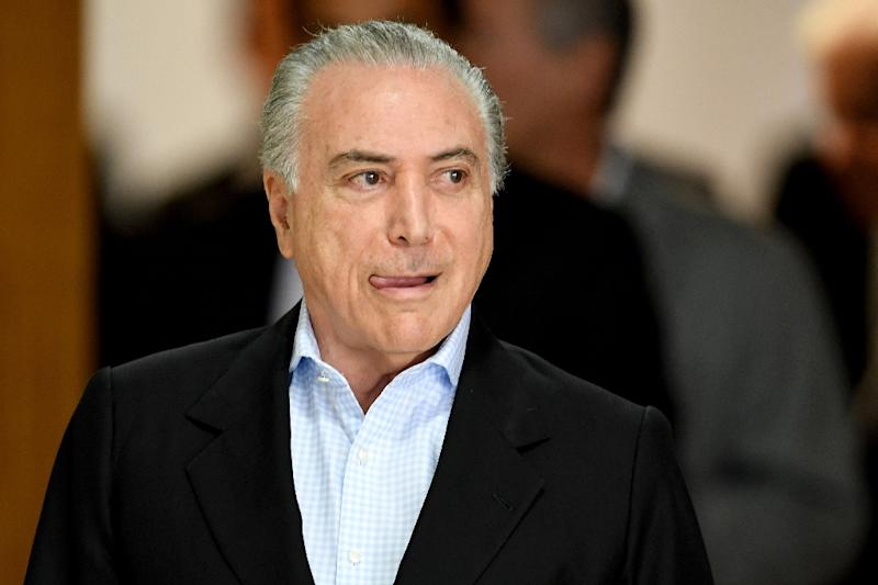 Brazilian President Michel Temer arrives to offer a press conference at Planalto Palace in Brasilia, on November 27, 2016