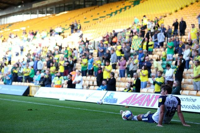 Preston's Ryan Ledson sits on the pitch in front of fans at Carrow Road