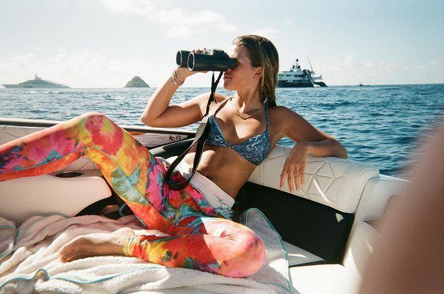 "<p>The model shared a photograph of herself on a boat in a blue bikini top and multicoloured, patterned trousers.</p><p>'Me looking into 2021,' Richie captioned the post. </p><p><a href=""https://www.instagram.com/p/CJXL0HFJm5n/?utm_source=ig_web_copy_link"" rel=""nofollow noopener"" target=""_blank"" data-ylk=""slk:See the original post on Instagram"" class=""link rapid-noclick-resp"">See the original post on Instagram</a></p>"